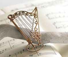 Hey, I found this really awesome Etsy listing at https://www.etsy.com/listing/169067864/personalized-handmade-harp-ornament