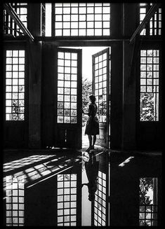 Architecture House Discover Still Waiting Poster Beautiful black and white photo art of a woman standing waiting in a doorway. The motifs lines and contrasts are nicely reflected in the floor to give extra depth to this poster. Black And White Photo Wall, White Picture Frames, Black And White Posters, Black And White Aesthetic, Black And White Pictures, Black And White Photography, Line Photography, Photography Themes, Reflection Photography