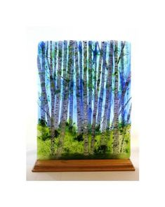 """Summer Birch - The summer birch is achieved with multiple firings in the kiln. The birch trees themselves are layered giving remarkable depth to the piece. I describe it as the birches being """"on the glass, in the glass and behind the glass."""" The technique to achieve this is bothintensive and rewarding."""