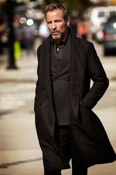 Shop this look on Lookastic:  http://lookastic.com/men/looks/black-long-sleeve-shirt-black-double-breasted-blazer-black-overcoat-black-jeans/8317  — Black Long Sleeve Shirt  — Black Double Breasted Blazer  — Black Overcoat  — Black Jeans