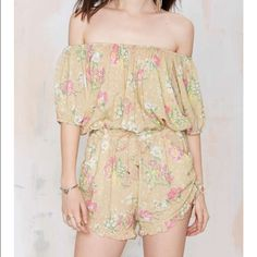 #243 nasty gal give those shoulders the spotlight. The Sundancer Romper is beige and features floral print in pink, white, and green, off-the-shoulder design, drawstring waistband and side seams at shorts, pockets, and ruffle detail at hem. We love it with gladiator sandals and a distressed denim jacket. By Spell.*Rayon  *Runs true to size  *Model is wearing size small  *Hand wash cold  *Imported Nasty Gal Dresses