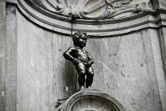 Manneken Pis  (literally Little Man Pee in Marols), is a famous Brussels landmark