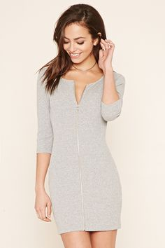A ribbed knit bodycon dress featuring an exposed zipper front, 3/4 sleeves, a scoop neckline, and a marled pattern.