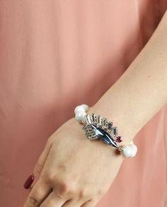 $100 Blue Pearls Swarovski Crystals Embellished Wing Bracelet by Miss Julie  Shop here: http://www.trendcy.com/blue-pearls-swarovski-crystals-embellished-wing-bracelet/