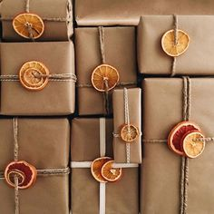 I've had a tray of dehydrated fruit sitting on our counter for the last week that honestly was probably never going to make it into garland (because so I used it for last minute wrapping instead! Thanks for the idea Christmas 2019, Simple Christmas, Christmas Crafts, Homemade Christmas, Natural Christmas Decorations, Christmas Ideas, Modern Christmas, Christmas Paper, Scandinavian Christmas