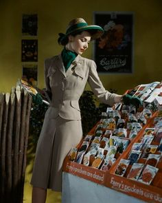 Looking smartly elegant while shopping for seeds during the early 1940s.