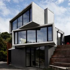 Australian guesthouse made up of staggered concrete and timber boxes.