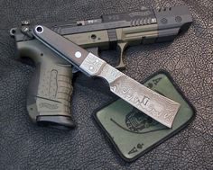 Google Image Result for http://www.gagecustomknives.com/DamascusMiniRazor.jpg