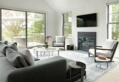 Modern interior design and bright room decorating ideas that blend black and white with blue accents look cool and pleasant, adding a sophisticated feel to this old home redesign. Choosing minimalist style and black and white decorating colors, mixing them with warm brown colors of natural wood and