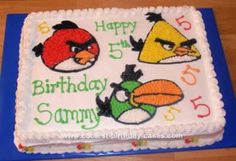 Homemade Angry Birds Cake: I made this Angry Birds cake for a friend's son. This is a 11 x 15 marble sheet cake with pure white butter cream icing. I printed out coloring pages of