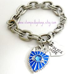 Hey, I found this really awesome Etsy listing at https://www.etsy.com/listing/157016799/police-wife-charm-bracelet-police-badge