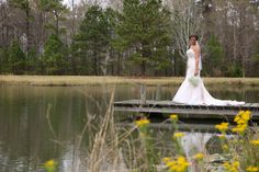 We love bridal pictures with depth! This reflective photo is breathtaking! Kudos to Elizabeth Looney Photography for capturing this image! Click the image to learn more!