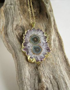 I fucking want this! https://www.etsy.com/listing/183852633/amethyst-druzy-stalactite-necklace-agate