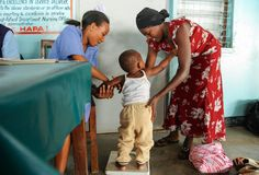 A nurse and patient at Kilifi County Hospital, where Dr. Osier works. (Photo credit: Kenya Medical Research Institute (KEMRI) Welcome Trust)