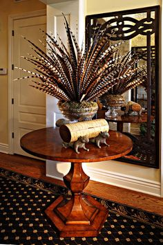 This feather arrangement belongs in my home!