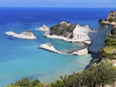 The Best Island Beaches in Europe: Readers' Choice: 12. CORFU (IONIAN ISLANDS), GREECE Cape Drastis, on the northwestern tip of Corfu, is barely 50 nautical miles from the heel of Italy across the Ioanian Sea. The peninsula is studded with tiny beaches, accessible only on foot or by water. Awards