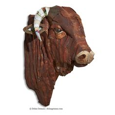 Commissioned life-size Santa Gertrudis bull sculpture constructed from hand-cut salvaged tin metal adhered to carved wood form. Custom requests welcome. Artist: Dolan Geiman.   Tags: metal sculpture, metal art, cow art, cow sculpture, bull, industrial, ranch, Texas, western