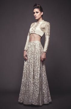 Off white zardosi and pitta embroidered lehenga set. By SVA. Graceful abstract prints with an edgy touch.