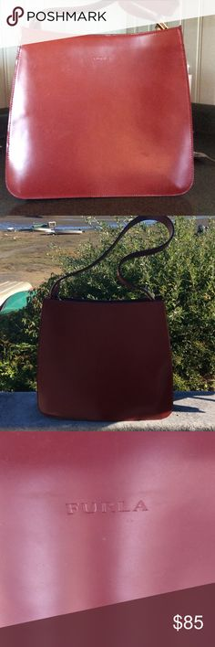 """Authentic FURLA Shoulder Bag in Polished Leather Authentic FURLA Shoulder Bag in Polished Leather with Gold Hardware. Color is rich Crimson Burgundy.  Embossed FURLA logo on front. Exterior Zip Closure. Interior Zip Pocket. Excellent Condition. Never Used A few light scuffs due to packing, hardly noticeable (see pics). Measures shown on """"size"""" tab. Furla Bags Shoulder Bags"""