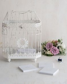 This vintage bird cage card holder is the perfect statement piece for any vintage inspired wedding. Both beautiful and functional, this card holder is also great for holding wishes from your guests, florals, and other trinkets in a truly unique way.
