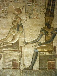 https://flic.kr/p/CNj1Q   Egypt 2007   The Ptolemaic temple of Deir el-Medina was dedicated to the goddesses Hathor and Ma'at. It is a small building which you enter via a vestibule that has two papyrus columns. The right (North) chapel was dedicated to Amun-Ra-Osiris, and its reliefs show the king before various deities, including Hathor, Isis, Nepthys, Horus, Anubis, Mut, Amun, and others. Hathor is on the left throne, Amun-Ra on the right throne.