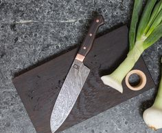 """7.5"""" Santoku, Carbon Damascus, Random Twist Pattern. Bolsters and Hardware are Copper with African Rosewood Scales - Monolith Studio Knives"""