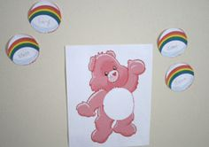 Draw Oopsy bear and have blank bellys the kids draw their own pictures on before they pin them.