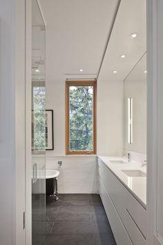 Montauk slate floor and Caesarstone countertops in bathroom of Toronto renovation by Modern Nest Design + Construction.