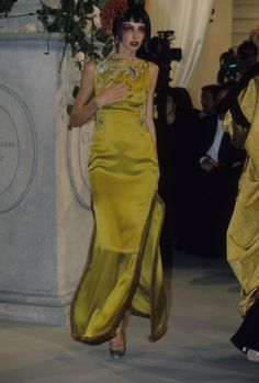 A model wears the Galliano for Dior dress made famous by Nicole Kidman at the 1997 Oscars.