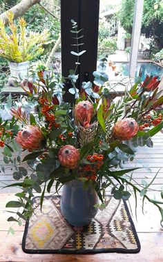 """Free-form arrangements like this one provide the, """"just been picked from the garden"""", look that instantly welcomes guests into a room. We created this arrangement for an Airbnb called Glasshouse in the Cape Winelands of Stellenbosch. Glass House, Cape, Table Decorations, Garden, Room, Furniture, Home Decor, House Of Glass, Mantle"""