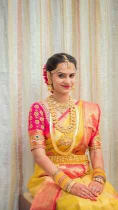 South Indian bride. Gold Indian bridal jewelry.Temple jewelry. Jhumkis. Pink and yellow silk kanchipuram sari.Braid with fresh jasmine flowers. Tamil bride. Telugu bride. Kannada bride. Hindu bride. Malayalee bride.Kerala bride.South Indian wedding.