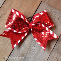 """Cheer bow if the day. by @thehaircandyshop """"One of my fav. #cheerbows #peppermint Tag #cheerbowoftheday to be featured. #cheerbow #cheerbows #christmas #cheer #cheerleading #cheerleader #cheerleaders #allstarcheer #glitter #allstarcheerleading #cheerislife #bows #hairbow #hairbows #bling #hairaccessories #candycane #bigbow #teambows #fabricbows #hairclips"""