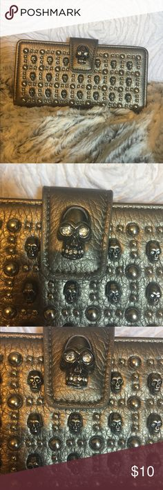 Skull wallet Skull studded wallet. Excellent condition. Has many slots for cards, ID's, etc. pewter/grey in color. Bags Wallets