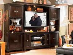 Bring beauty to your TV room with this modern entertainment center available at Furniture Plus!