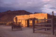 old adobe desert | An old adobe is lit up by the fading sun in Old Tucson with the Tucson ...