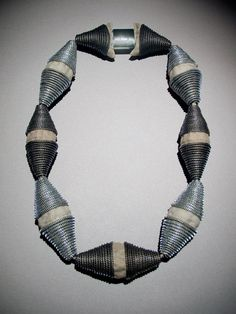 Necklace made out of zippers by artist/designer Kate Cusack.  She makes pins and bracelets too!
