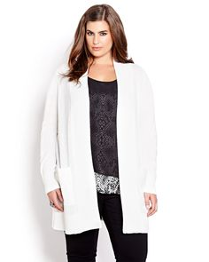 Wear sequins to work in this chic long sleeve cardigan that combines a soft cozy knit, flowing lines and trendy sequin detail at the elbow and front pockets. Plus size, open front, 32 inch length. Understated glam for a bit of 9 to 5 luxe!