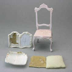 Cardboard templates, fabric and a miniature chair frame ready for an upholstery project. Miniature Chair, Miniature Furniture, Dollhouse Furniture, Wooden Dollhouse, Diy Dollhouse, Wooden Dolls, Dollhouse Miniatures, Cardboard Dollhouse, Mini Chair