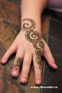 A swirl filled mehndi design. The blog describes how to do this design easily. Blog.hennaart.ca.