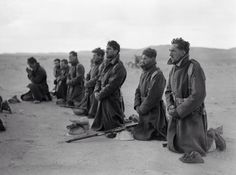 Free French soldiers attend a mass at sunrise during the siege of Bardia, Libya 1940.
