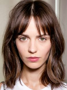 8 Life-Saving Styling Tips for Girls With Bangs via @ByrdieBeauty