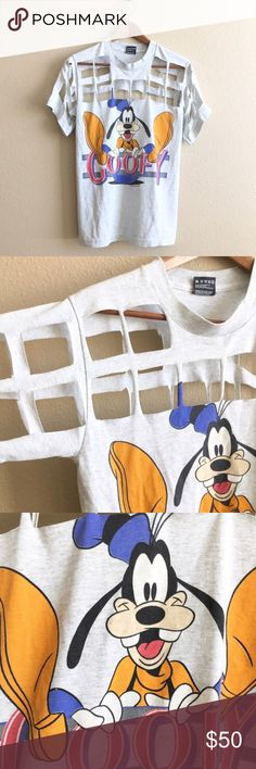 90s/ Goofy gridlock tee Vintage Goofy tee with grid cutout. One of a kind!  BRAND: Screen Stars MATERIAL: 50/50 YEAR/ERA: 90s LABEL SIZE: S BEST FIT: S  MEASUREMENTS:  chest: 17 inches length: 25.5 inches  **Listed as LF for search visibility *** Bought from another seller but didn't like how it fit on me… these pictures are hers! Just trying to make money back. LF Tops Tees - Short Sleeve