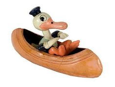 Antique Donald Duck in canoe. I seem to remember being out somewhere and you just LOVED vintage toys!
