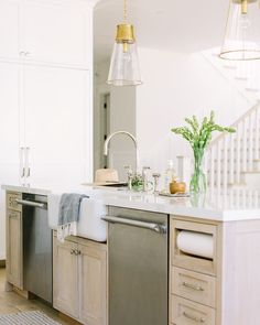 Wood island with farmhouse sink and polished nickel hardware
