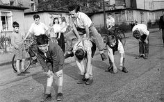 A group of boys play leap-frog in the street, watched by their friend Old Pictures, Old Photos, Vintage Photos, Vintage Photographs, Frog Games, My Childhood Memories, Sweet Memories, The Good Old Days, Games For Kids
