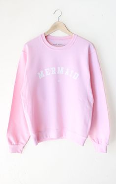 "- Description Details: Super cozy oversized sweatshirt in pink with print featuring 'Mermaid IRL'. Brand: NYCT Clothing. Unisex, oversized/loose fit. Measurements: (Size Guide) XS/S: 40"" bust, 27"" len"