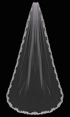 This lace cathedral veil has a floral embroidered edge that is adorned with pearls and rhinestones. A beautiful veil for a radiant bride! It is 108 inches long and 72 inches wide, on a four inch metal