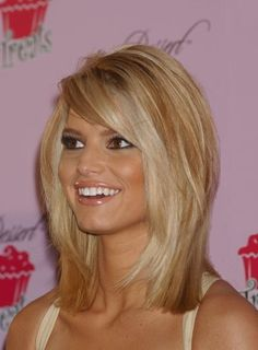 great shoulder length hair cut with side swept bangs via jessica simpson