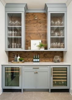 The blue-gray Butler pantry painted in Benjamin Moore Solitude … The blue-grey butler's pantry, painted in Benjamin Moore Solitude features beverage and wine refrigerators and beautiful glass front cabinetry. Wood shiplap backsplash is Knotty New Kitchen, Kitchen Dining, Kitchen Pantry, Dining Room With Bar, Dining Room Cabinets, Wall Pantry, Kitchen Wet Bar, Dining Room Storage, Pantry Doors