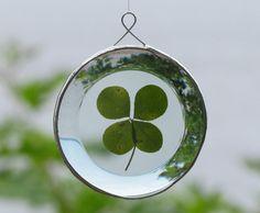 Faith, Hope, Love and Luck Genuine Four Leaf Clover as a  Round Beveled Glass Ornament. $25.00, via Etsy.
